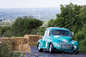 Picture of a Morris Minor performance project taking part in a Shere Hill Climb.